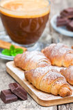 Homemade fresh chocolate croissant  with cup of cappuccino Stock Images