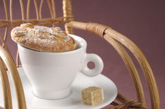 Homemade fresh cookies over coffee cup on a rocking chair Stock Photo