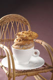 Homemade fresh cookies over coffee cup on a rocking chair Royalty Free Stock Images