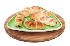 Homemade fresh croissants on a green triangular plate Royalty Free Stock Images