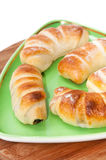 Homemade fresh croissants on a green triangular plate Stock Image