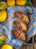 Homemade fresh croissants with lemon icing, top view Royalty Free Stock Photo