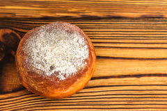 Homemade fresh donut sprinkled with powdered sugar on wooden table, top view. with space for text Stock Photos