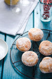 Homemade fresh donuts on cooling tray stock photography