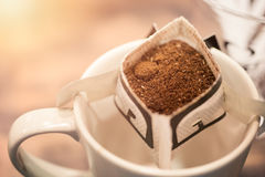 Homemade fresh drip coffee with paper filter cup. Stock Images
