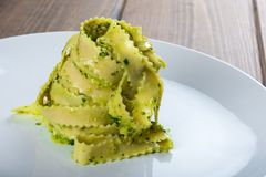 Homemade fresh egg pasta with pesto sauce Stock Photography