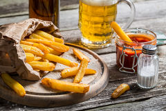 Homemade fresh fries with beer Royalty Free Stock Photos