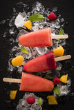 Homemade fresh and fruity ice lollies. Stock Photo
