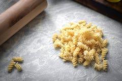 Homemade fresh handmade pasta with flour. Homemade fresh pasta and kitchen table with flour. Hand made fusilli stock image