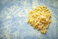 Homemade fresh handmade pasta with flour. Homemade fresh pasta and kitchen table with flour. Hand made fusilli. Top view with copyspace royalty free stock photos