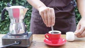 Homemade fresh hot espresso cup by moka pot stock video