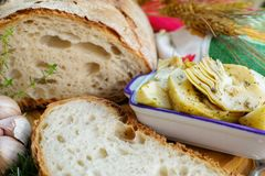 Homemade fresh italian bread and artichokes in brine with spices Stock Photo