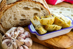 Homemade fresh italian bread and artichokes in brine with spices Stock Photos