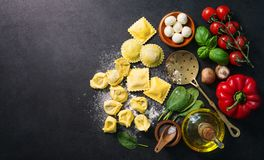 Homemade fresh Italian ravioli pasta. On dark background, top view Stock Photography