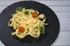 Homemade fresh pasta spaghetti dish with tomato and oregano stock photo