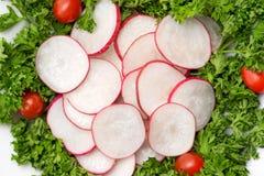 Homemade fresh radishes vegetable salad on table. Close-up. Homemade fresh radishes vegetable salad on table. Close-up Royalty Free Stock Image