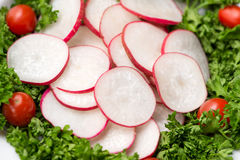 Homemade fresh radishes vegetable salad on table. Close-up. Stock Photo