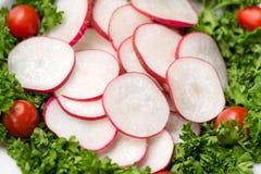 Homemade fresh radishes vegetable salad on table. Close-up. Homemade fresh radishes vegetable salad on table. Close-up Stock Photo