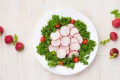 Homemade fresh radishes vegetable salad on table. Close-up. Homemade fresh radishes vegetable salad on table. Close-up Stock Photography