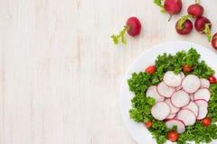 Homemade fresh radishes vegetable salad on table. Close-up. Homemade fresh radishes vegetable salad on table. Close-up Royalty Free Stock Photos