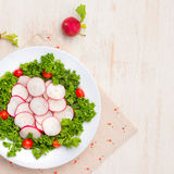 Homemade fresh radishes vegetable salad on table. Close-up. Stock Images