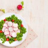 Homemade fresh radishes vegetable salad on table. Close-up. Homemade fresh radishes vegetable salad on table. Close-up Stock Images