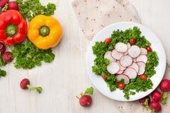 Homemade fresh radishes vegetable salad on table. Close-up. Homemade fresh radishes vegetable salad on table. Close-u Royalty Free Stock Images