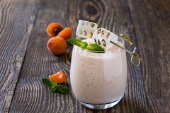 Homemade fresh summer fruits milkshake with toasted marshmallow Stock Photography