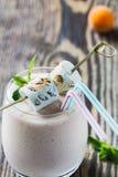 Homemade fresh summer fruits milkshake with toasted marshmallow Royalty Free Stock Images