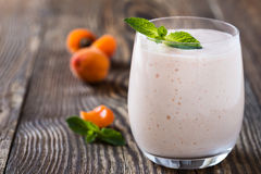 Homemade fresh summer fruits smoothie with ripe apricots Stock Images