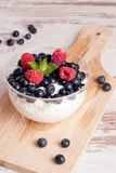 Homemade fresh yogurt with blueberries and raspberries. Fresh yogurt with blueberries and raspberries. Healthy Breakfast, vertical Stock Images