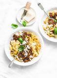 Homemade freshness pappardelle pasta with beef bolognese sauce on a light background. Served lunch table. Top view stock images