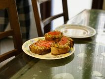 Homemade Fried Garlic Bread Slices with Cheese, Tomatoes and Dill. Fast Food Stock Photography