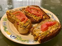 Homemade Fried Garlic Bread Slices with Cheese, Tomatoes and Dill. Fast Food Stock Photo