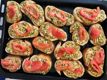 Homemade Fried Garlic Bread Slices with Cheese, Tomatoes and Dill. Fast Food Royalty Free Stock Images