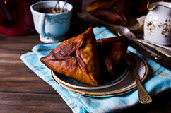 Homemade fried triangular pastry. On a dark background. Selective focus royalty free stock images