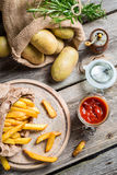 Homemade fries with ketchup and salt Royalty Free Stock Image