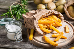 Homemade fries with salt and herbs Royalty Free Stock Images