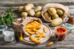 Homemade fries with salt and herbs Royalty Free Stock Photo