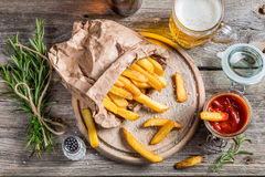 Homemade fries served with beer Stock Image