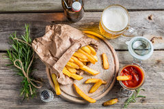 Homemade fries served with beer Stock Photography