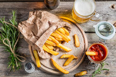 Homemade fries served with beer Royalty Free Stock Photography