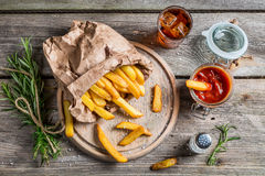 Homemade fries served with cold drink Stock Photo