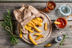 Homemade fries served with cold drink Stock Image
