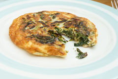 Homemade Frittata with onions, vegetable and parmesan cheese. Without one piece stock image