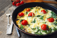 Homemade frittata with tomatoes and herbs Stock Image