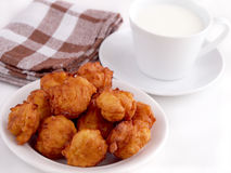 Homemade fritters and cup of milk Stock Image