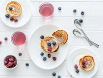 Homemade fritters with raspberries and blueberries Royalty Free Stock Photos