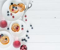 Homemade fritters with raspberries and blueberries Stock Photography
