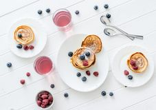 Homemade fritters with raspberries and blueberries Stock Image